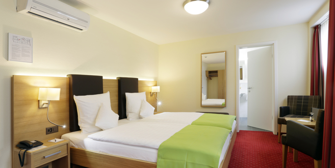 Double Rooms Standard - inside view and bed